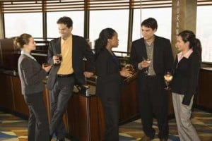 Group of people networking in a bar