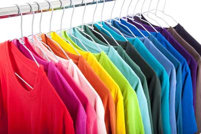 coloured t-shirts on hangers